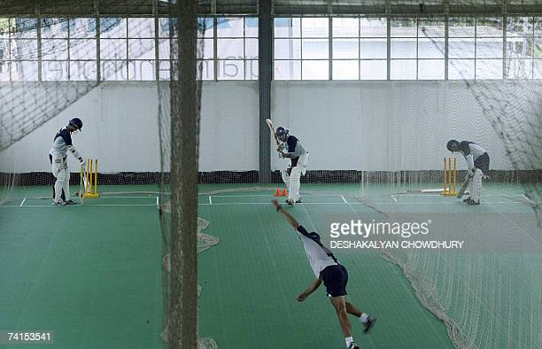 Indian cricketers Sourav Ganguly Wasim Jaffer and Sachin Tendulkar practice batting during an indoor session of net practice for the Indian Test...
