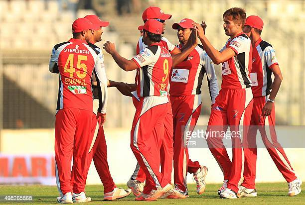 Chittagong Vikings cricketers Mohammad Amir celebrates after the dismissal of the Rangpur Riders cricketers Lendl Simmons during the Bangladesh...
