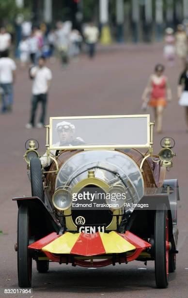 Chitty Chitty Bang Bang makes its way up The Mall towards Buckingham Palace where the Queen is hosting a special garden party for two thousand...