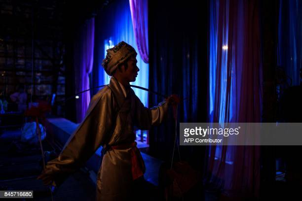 A Chiu Chow opera actor prepares for a performance during an event to mark the Hungry Ghost Festival in Hong Kong on September 11 2017 The festival...