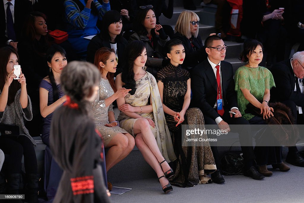 Chiu-ti Jansen, Zhang Meng, and Gong Xiliang attend the Tadashi Shoji Fall 2013 fashion show during Mercedes-Benz Fashion Week at The Stage at Lincoln Center on February 7, 2013 in New York City.