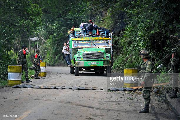 A 'chiva' vehicle of public transportation passes by a checkpoint in El Palo department of Cauca Colombia on February 5 after car bombs exploded Two...
