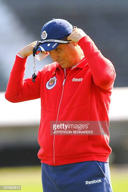 Chivas de Guadalajara coach Jose Luis Real conducts a training session at Olimpico Monumental stadium in Porto Alegre Brazil August 17 on the eve of...