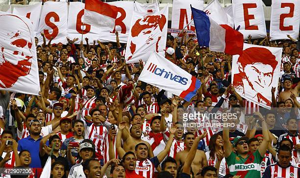 Chivas' fans cheer for their team during their Mexican Clausura 2015 tournament football match against Morelia at Omnilife stadium on May 10 2015 in...