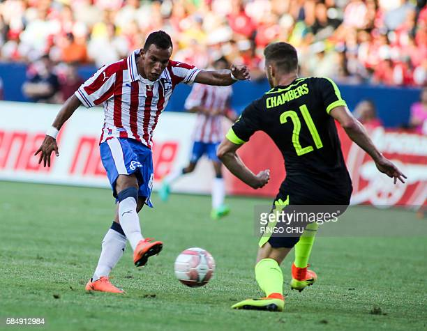 Chivas Guadalajara forward Daniel Gonzalez kicks the ball against Arsenal defender Calum Chambers during their friendly soccer match at StubHub...