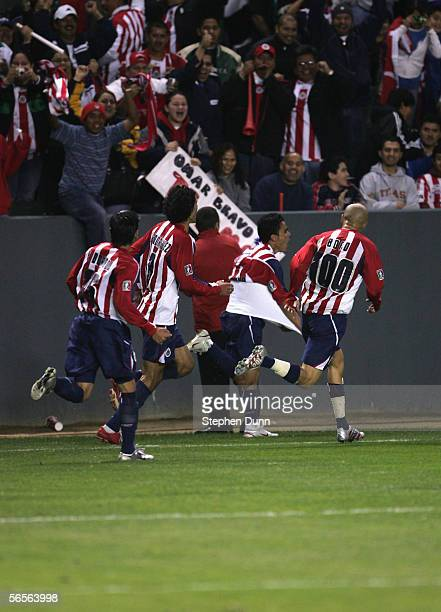 Chivas of Guadalajara players celebrate after an Omar Bravo goal in extra time tied their match with Necaxa and put them in the final of Interliga...