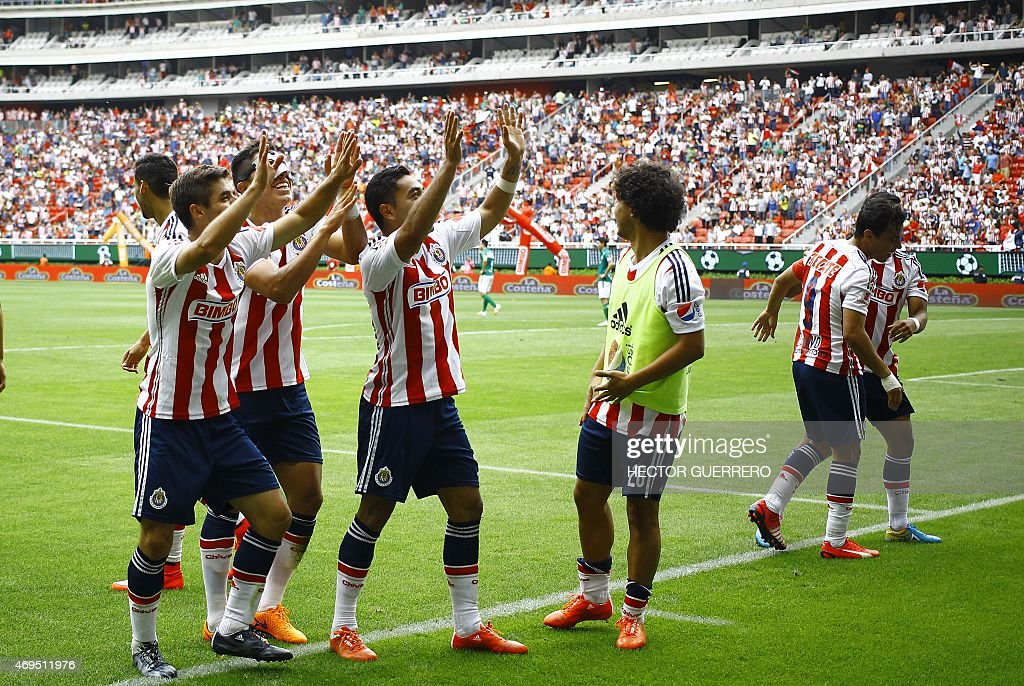 Chivas players celebrate after scoring during their Mexican Clausura 2015 tournament football match against Leon at Omnilife stadium in Guadalajara...
