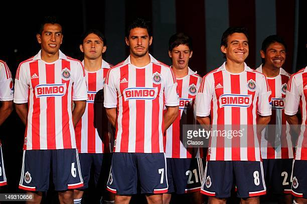 Chivas players pose for a photograph at the launch of the new jersey of Chivas at the Omnilife stadium on July 25 2012 in Guadalajara Mexico
