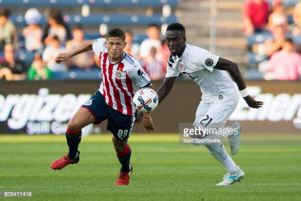 Chivas U20s forward Jose de Jesus Godinez and MLS Homegrown and Philadelphia Union midfielder Derrick Jones watch the ball in the first half during a...