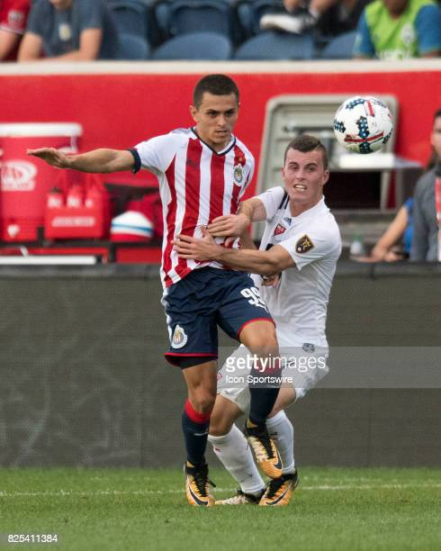 Chivas U20s midfielder Kevin Magana and MLS Homegrown and Real Salt Lake midfielder Brooks Lennon battle for the ball in the first half during a...