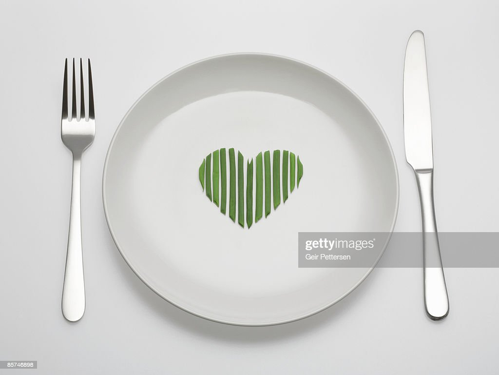 Chives arranged in a heart shape on plate