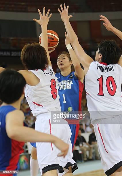 ChiWen Lin of Chinese Taipei competes the ball with Maki Takada and Ramu Tokashiki of Japan in semifinal match between Japan and Chinese Taipei...