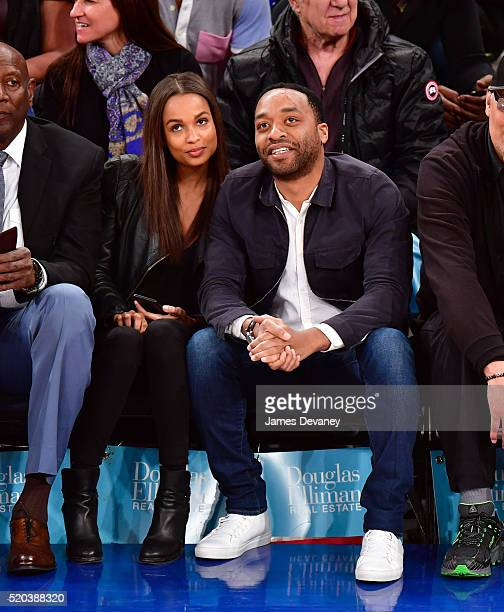 Chiwetel Ejiofor and guest attend the Toronto Raptors vs New York Knicks game at Madison Square Garden on April 10 2016 in New York City