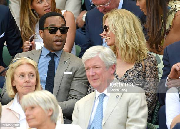Chiwetel Ejiofor and Jennifer Barrons attend day eleven of the Wimbledon Tennis Championships at Wimbledon on July 10 2015 in London England