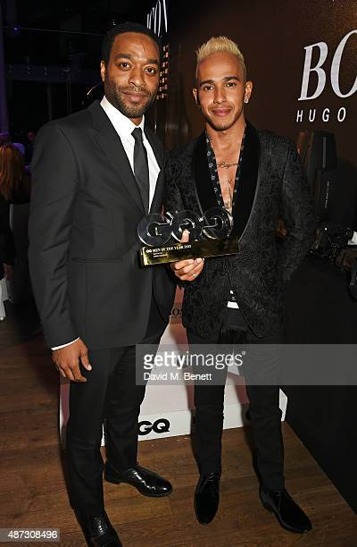 Chiwetel Ejiofor and Lewis Hamilton winner of the Sportsman of the Year award attend the GQ Men Of The Year Awards at The Royal Opera House on...