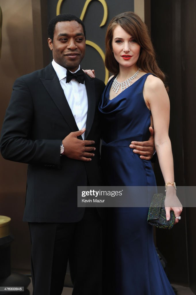 <a gi-track='captionPersonalityLinkClicked' href=/galleries/search?phrase=Chiwetel+Ejiofor&family=editorial&specificpeople=213998 ng-click='$event.stopPropagation()'>Chiwetel Ejiofor</a> and Sari Mercer attend the Oscars held at Hollywood & Highland Center on March 2, 2014 in Hollywood, California.