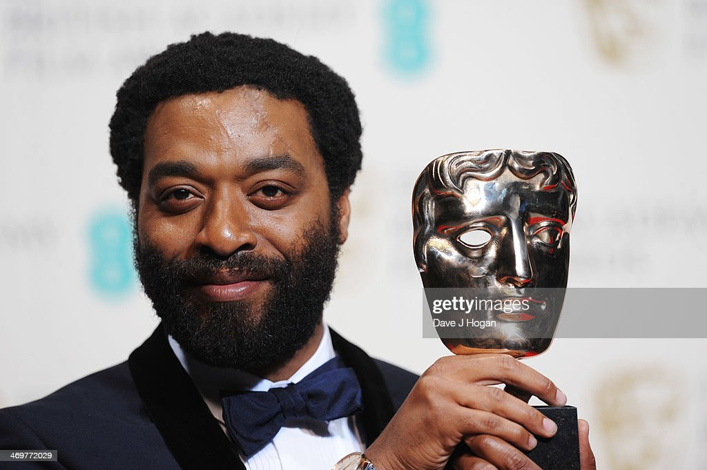 <a gi-track='captionPersonalityLinkClicked' href=/galleries/search?phrase=Chiwetel+Ejiofor&family=editorial&specificpeople=213998 ng-click='$event.stopPropagation()'>Chiwetel Ejiofor</a> poses with his Best Actor Award in the winners room at the EE British Academy Film Awards 2014 at The Royal Opera House on February 16, 2014 in London, England.