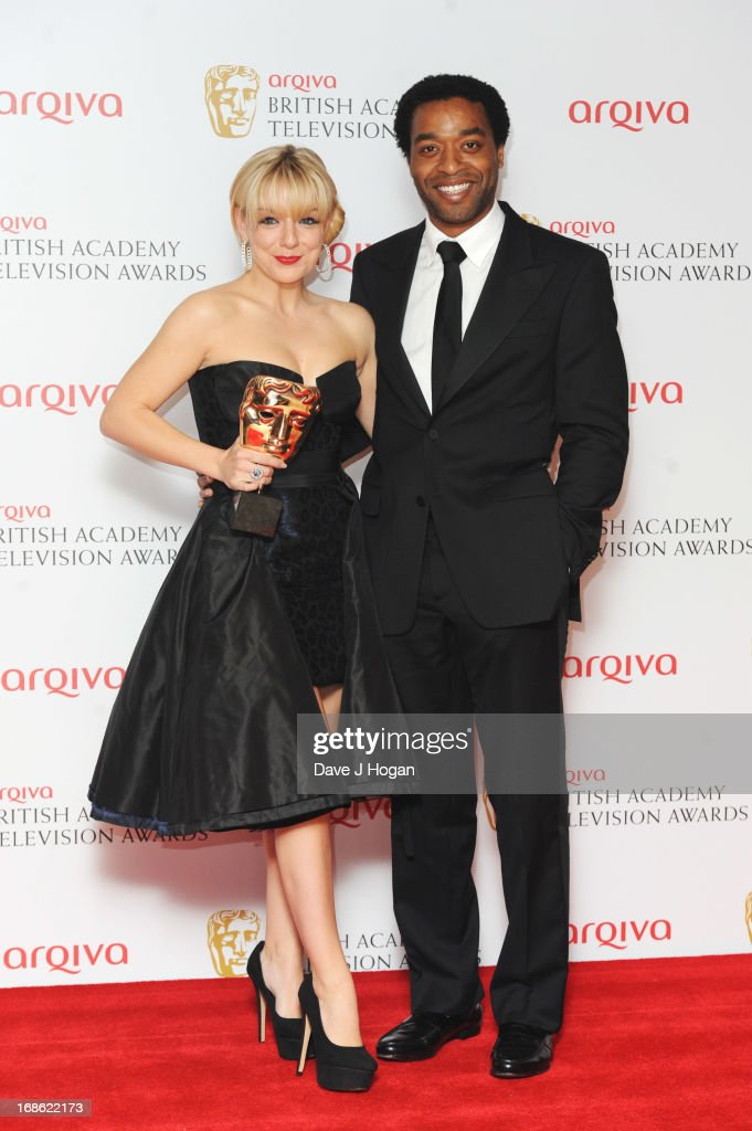 <a gi-track='captionPersonalityLinkClicked' href=/galleries/search?phrase=Chiwetel+Ejiofor&family=editorial&specificpeople=213998 ng-click='$event.stopPropagation()'>Chiwetel Ejiofor</a> poses with <a gi-track='captionPersonalityLinkClicked' href=/galleries/search?phrase=Sheridan+Smith&family=editorial&specificpeople=4159304 ng-click='$event.stopPropagation()'>Sheridan Smith</a> after presenting her with the Best Actress Award in front of the winners boards at the BAFTA TV Awards 2013 at The Royal Festival Hall on May 12, 2013 in London, England.