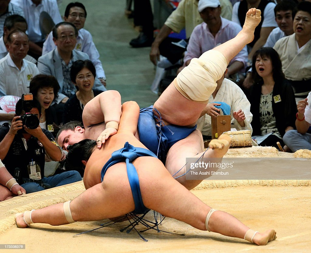 Chiyonokuni (front) throws Bulgarian sumo wrestler Aoiyama (top), whose real name is Daniel Ivanov to win during day five of the Grand Sumo Nagoya Tournament at Aichi Prefecture Gymnasium on July 11, 2013 in Nagoya, Aichi, Japan.