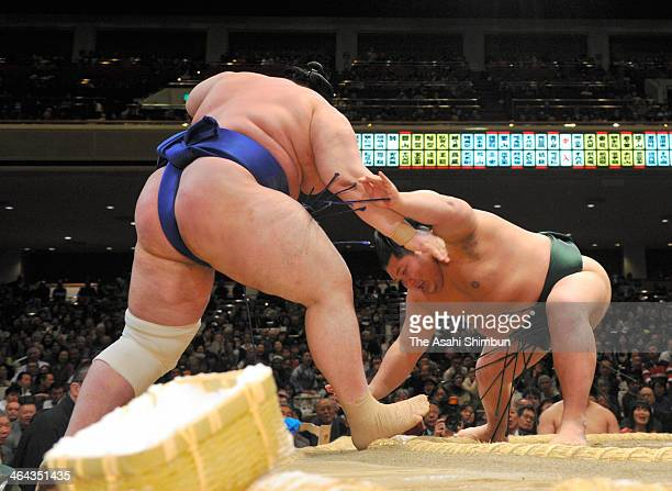 Chiyotairyu pushes out Bulgarian wrestler Aoiyama whose real name is Daniel Ivanov during to win day ten of the Grand Sumo New Year Tournament at...