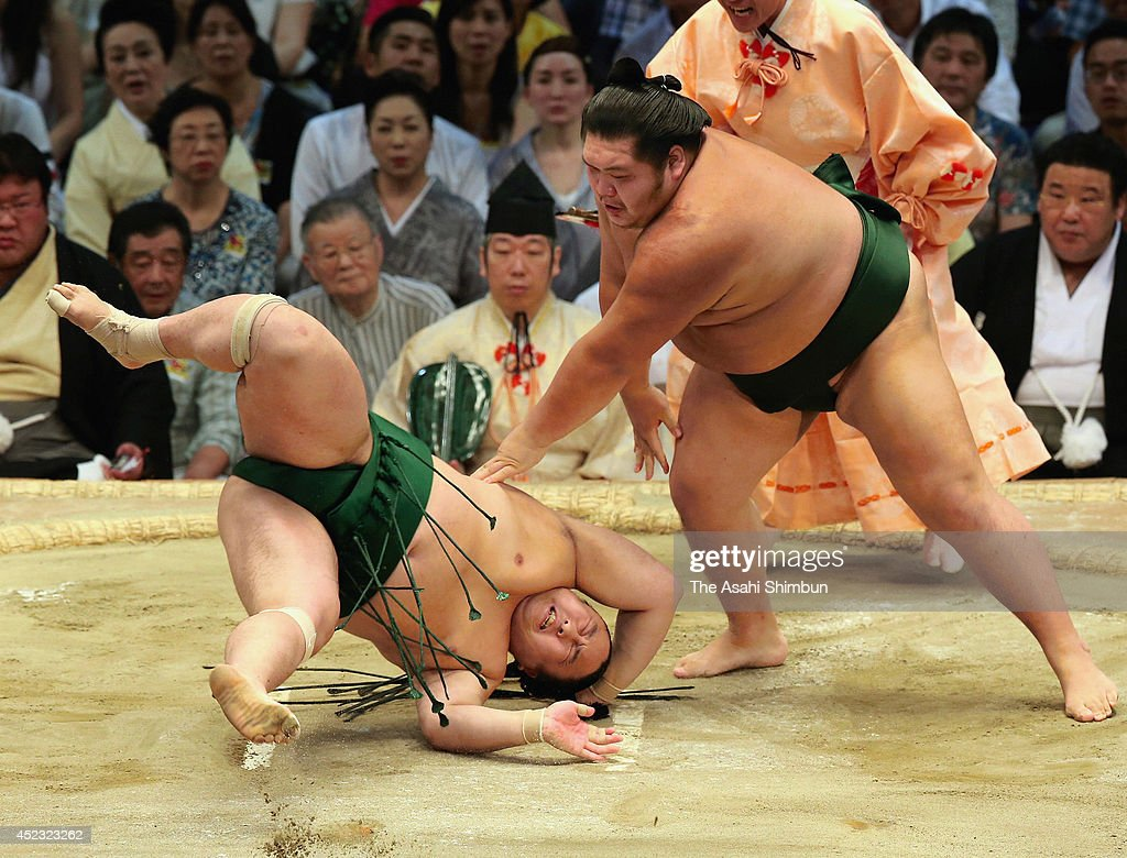 Chiyotairyu (R) throws Sadanoumi to win during day five of the Grand Sumo Nagoya Tournament at Aichi Prefecture Gymnasium on July 17, 2014 in Nagoya, Aichi, Japan.