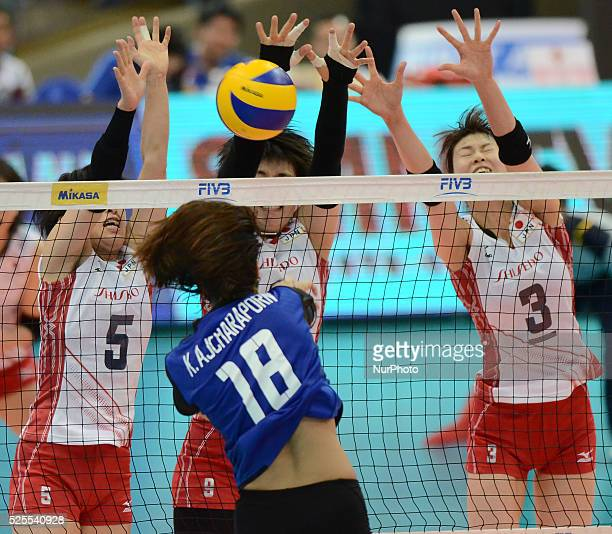 Chizuru Koto Haruyo Shimamura and Saori Kimura of Japan attemp to block the ball from Ajcharaporn Kongyot of Thailand during their FIVB World Grand...