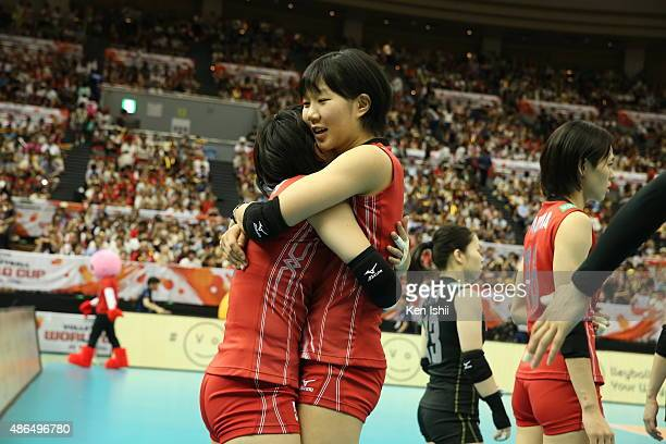 Chizuru Koto of Japan hugs her teammate Riho Otake prior to the match between Japan and Algeria during the FIVB Women's Volleyball World Cup Japan...