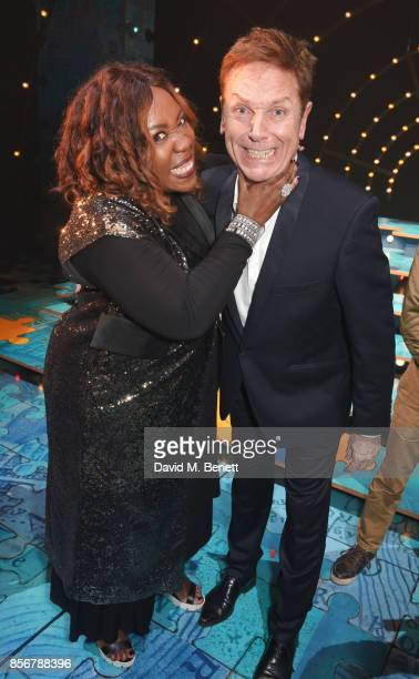 Chizzy Akudolu and Brian Conley pose backstage following the cast change press night performance of 'Annie' at The Piccadilly Theatre on October 2...