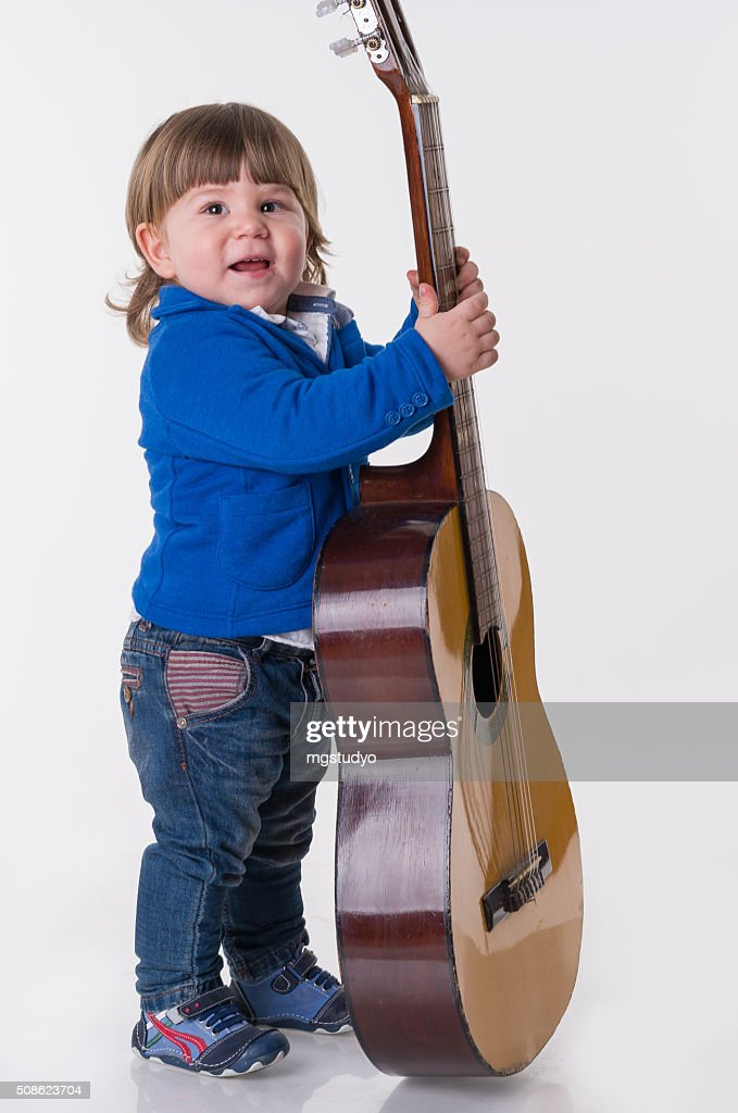 chıld play guitar : Stock Photo