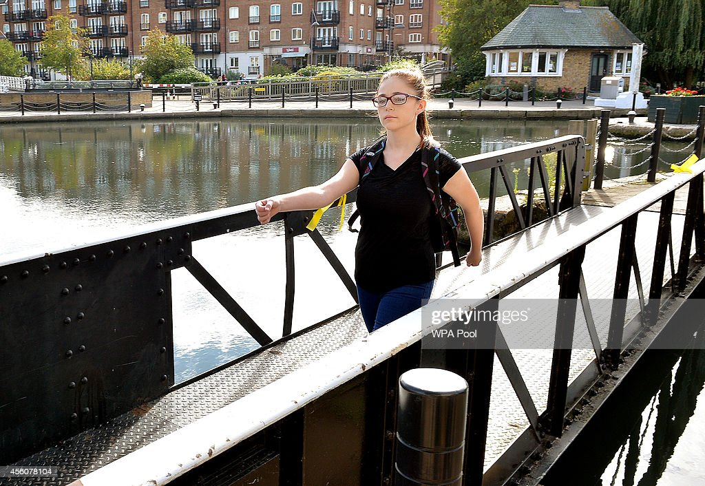Chloe, a 17-year-old police cadet walks across the bridge at the Brentford Locks as she reconstructs the last known movements of missing schoolgirl Alice Gross on September 25, 2014 in London, England. The hunt for Alice Gross from Hanwell, who went missing on August 28 is now being described as the largest police search operation since the 7/7 bombings of 2005. The police inquiry is now focused on a key suspect, Arnis Zalkalns, a Latvian builder, who was seen in the vicinity of Alice's last sighting.