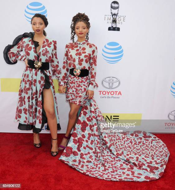 Chloe Bailey and Halle Bailey of Chloe X Halle arrive at the 48th NAACP Image Awards at Pasadena Civic Auditorium on February 11 2017 in Pasadena...