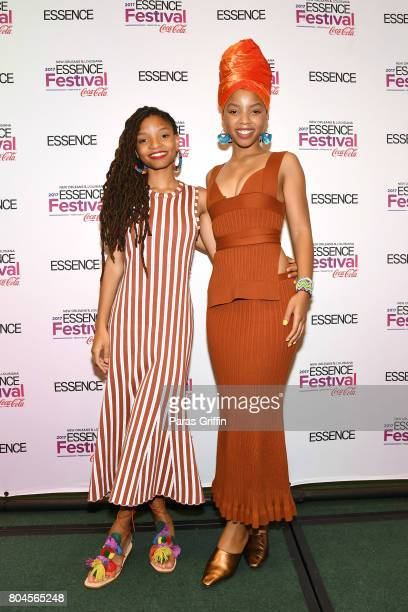 Chloe Bailey and Halle Bailey of Chloe x Halle pose in the press room at the 2017 ESSENCE Festival presented by CocaCola at Ernest N Morial...
