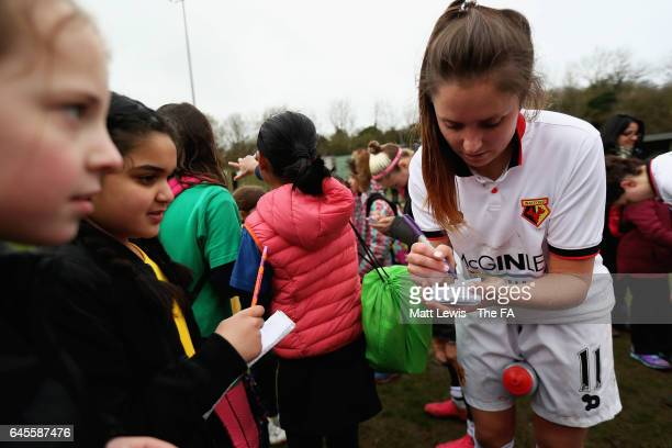 Chloe Bassett of Watford Ladies FC signs autographs after the WSL 2 match between Watford Ladies v London Bees on February 26 2017 in Kings Langley...