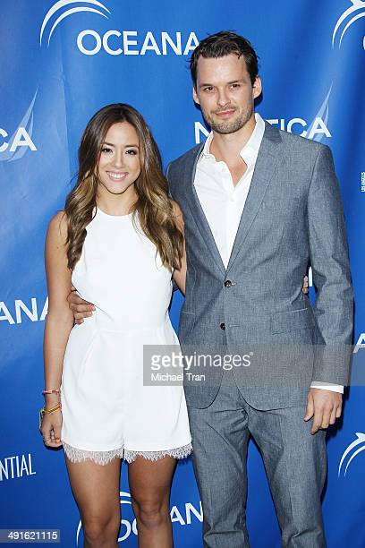 Chloe Bennet and Austin Nichols arrive Nautica and LA Confidential's Oceana Beach house party held at Marion Davies Guest House on May 16 2014 in...