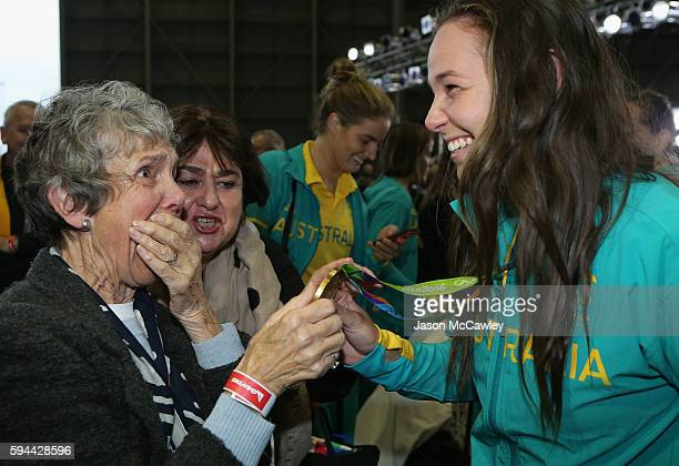 Chloe Dalton is greeted by family members during the Welcome Home for Australian Olympic Games athletes at Sydney International Airport on August 24...