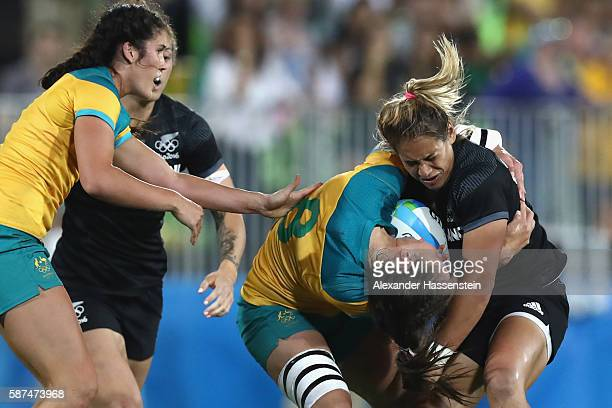 Chloe Dalton of Australia is tackled by Kayla Mcalister of New Zealandduring the Women's Gold Medal Rugby Sevens match between Australia and New...