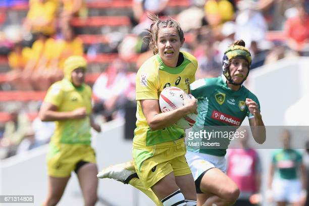 Chloe Dalton of Australia makes a break during the HSBC World Rugby Women's Sevens Series 2016/17 Kitakyushu pool match between Australia and Brazil...