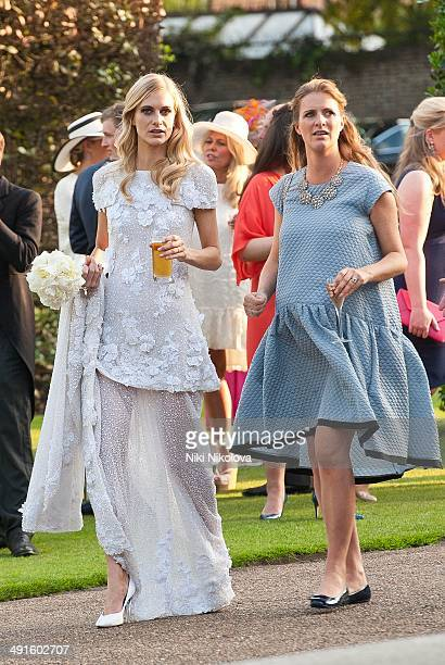 Chloe Delevingne and Poppy Delevingne are seen at Poppy Delevingnes and James Cook's wedding reception held in Kensington Palace Gardens on May 16...