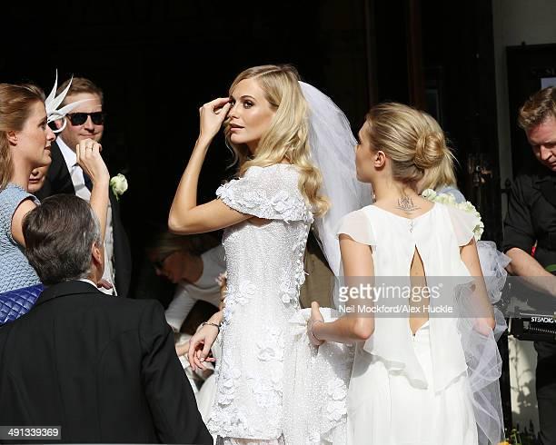Chloe Delevingne Charles Delevingne Poppy Delevingne and Cara Delevingne arriving at the wedding of Poppy Delevingne and James Cook on May 16 2014 in...