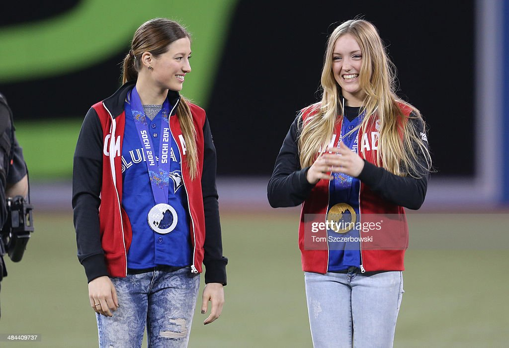 Chloe Dufour-Lapointe and her sister Justine Dufour-Lapointe who won silver and gold respectively in women's moguls skiing at the Winter Olympic Games in Sochi are introduced before the Toronto Blue Jays MLB game against the New York Yankees on April 4, 2014 at Rogers Centre in Toronto, Ontario, Canada.