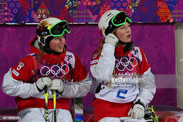 Chloe DufourLapointe of Canada and Justine DufourLapointe of Canada look on during the Ladies' Moguls Final 3 on day one of the Sochi 2014 Winter...