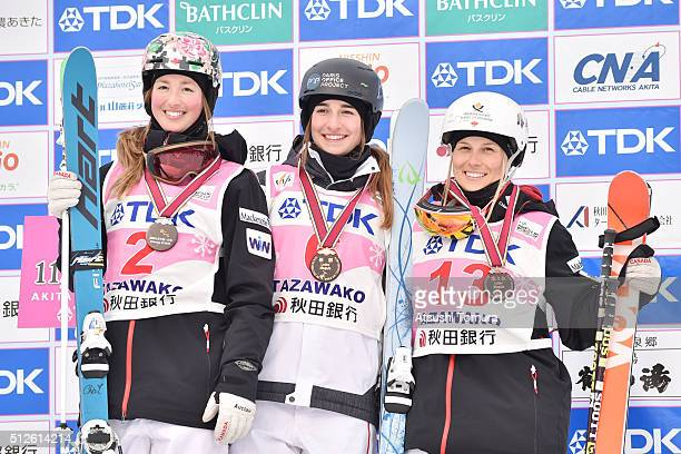 Chloe DufourLapointe of Canada Perrine Laffont of France and Audrey Robichaud of Canada pose on the podium after the Ladie's Mogul during the FIS...