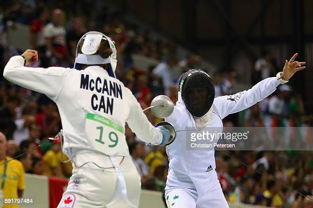 Chloe Esposito of Australia duels with Melanie McCann of Canada during the Modern Pentathlon Womens Fencing classification round on Day 13 of the Rio...