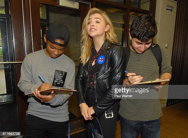 Chloe Grace Moretz talks to students as Jazmin Baylis and Tyler AlHamando register to vote during a voter registration event in support of Hillary...