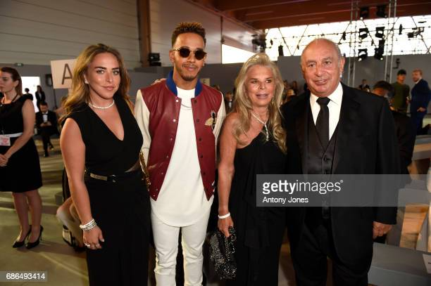 Chloe Green Lewis Hamilton Tina Green and Sir Philip Green attend the Fashion for Relief event during the 70th annual Cannes Film Festival at...