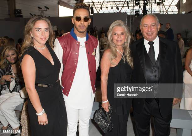 Chloe Green Lewis Hamilton Tina Green Sir Philip Green attend the Fashion for Relief event during the 70th annual Cannes Film Festival at Aeroport...