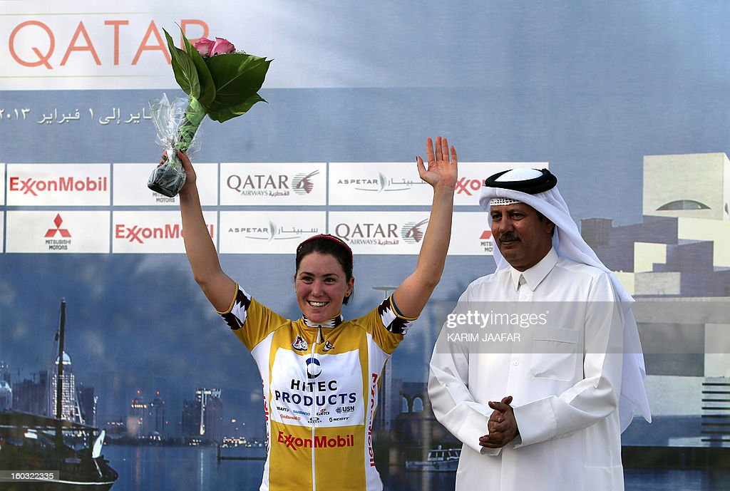 Chloe Hosking of Australia (L) wearing the golden jersey poses on the podium with Nasser al-Kaabi (R) member of Qatar Cycling Fedration, after winning the first stage of the Tour of Qatar women's cycling race on January 29, 2013. The route of the first stage covers 97 kilometres from the Qatar Islamic Art Museum to the southern city of Mesaieed.