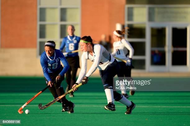Chloe Hunnable of the University of Connecticut takes on Hannah Barreca of Duke University during the 2013 NCAA Women's Division I Field Hockey...