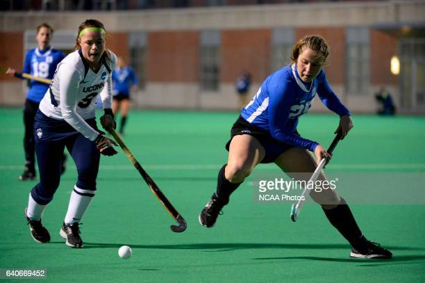 Chloe Hunnable of the University of Connecticut takes on Hunter Bracale of Duke University during the 2013 NCAA Women's Division I Field Hockey...