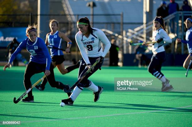 Chloe Hunnable of University of Connecticut races ahead of Paula Heimbach Duke University during the 2013 NCAA Women's Division I Field Hockey...